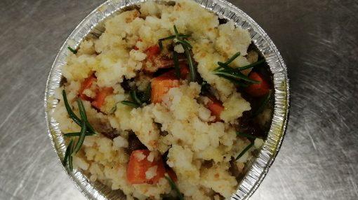 patata prima di infornare con sbriciolatura di composto e pane